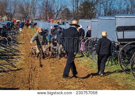 Plow In Muddy Field