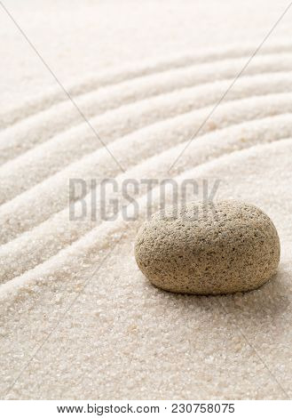 Zen Sand And Stone Garden With Raked Curved Lines With Selective Focus. Simplicity, Concentration Or