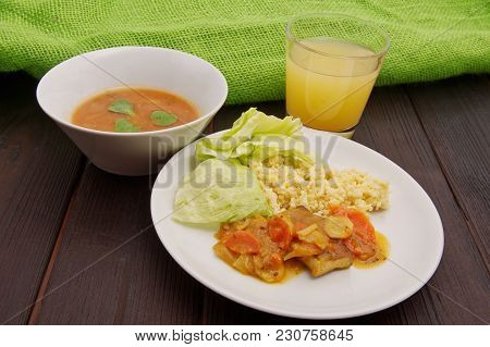 Tofu And Vegetables With Millet On A Table