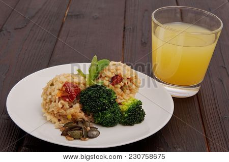 Rice Risotto With Vegetables On A Table