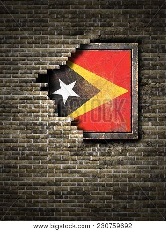 3d Rendering Of A Timor-leste Flag Over A Rusty Metallic Plate Embedded On An Old Brick Wall