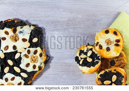 Yeast Cake With Poppy, Almond, Raisin And Cheese With Towel On White Wood