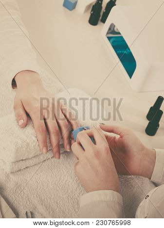 Woman Hand On Towel, Beautician File Nails. Beauty Wellness Spa Treatment, Manicure Concept