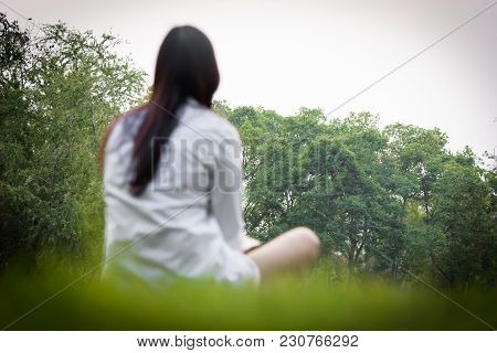 Beautiful Asian Woman Sitting Alone In The Garden With Happiness And Relaxing In The Evening With Su