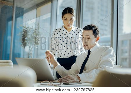 Searching For Appraisal. Pleasant Young Man Showing His Female Boss The Presentation Of His New Busi