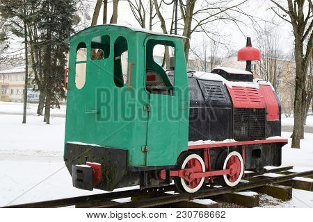 This Image Shows An Old Rail Vehicle Standing On A Narrow-gauge Railway.