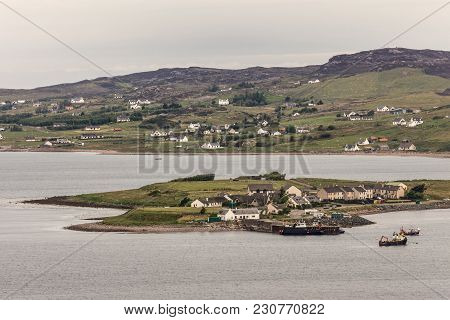 Aultbea, Scotland - June 9, 2012: Harbor Of Aultbea With Pier And A Few Fishing Vessels. Port At End
