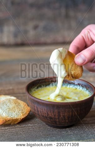 Bowl Of Cheese Dip With Toasts