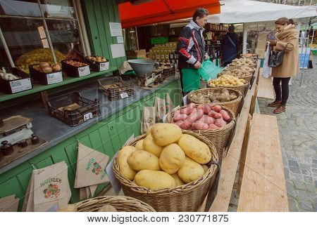 Munich, Germany - November 16, 2017: Local Farmer Selling Potato And Other Vegetables At City Market