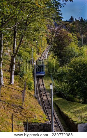The Funicular To The Overlook On Floyen Mountain In Bergen, Norway Ascends Through The Lush Green Tr