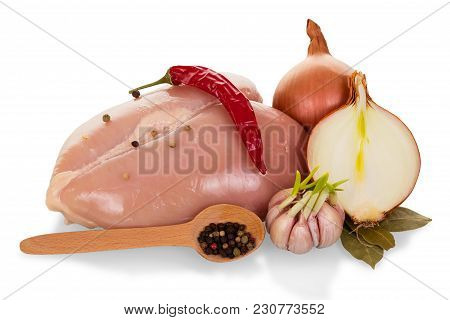 Fresh Chicken Breast, Garlic, Onion And Spices Isolated On White Background