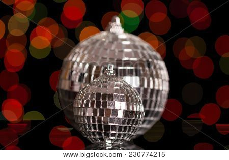 Two Brilliant Mirror Christmas Ball, On Dark Red Shimmering Background