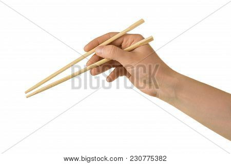 Japanese Wooden Sticks In Female Hand Isolated On White Background