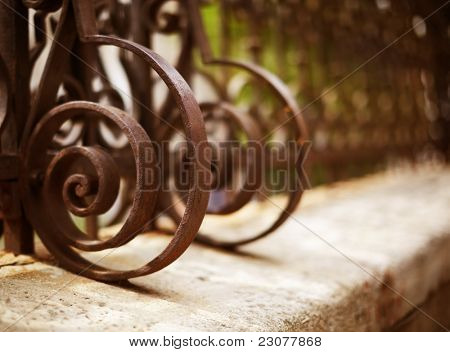 Wrought Iron Fence Detail (film toned photo f/x, selective focus  on nearest part)
