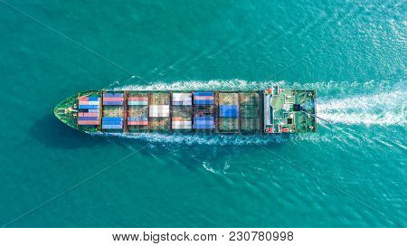 Container Ship In Export And Import Business And Logistics. Shipping Cargo To Harbor By Crane. Water