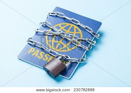 The Blue Passport Is Wrapped Around The Chain And Locked. Ban On Leaving The Country For Political R