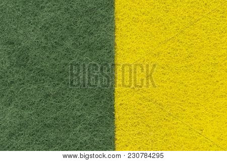Background Of Two Colored Green And Yellow Non-woven Fibrous Abrasive Material, Divided Vertically