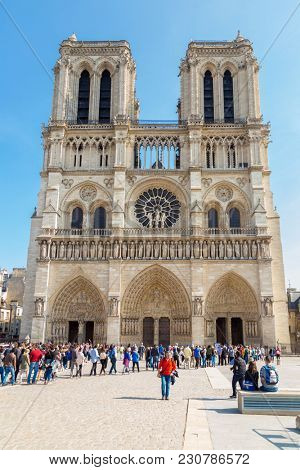 Paris, France, March 27 2017: famous Notre Dame cathedral facade saint statues. UNESCO World Heritage Site