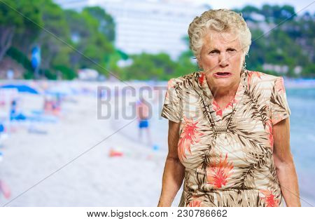 Portrait Of Angry Senior Woman, Outdoors