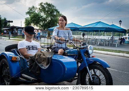 Young Couple Is Traveling On A Retro Motorcycle. Beautiful Woman With Boyfriend Went In Road Trip. S