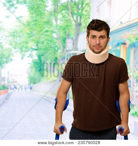 Man Walking On Crutches With Neck Brace, Outdoor