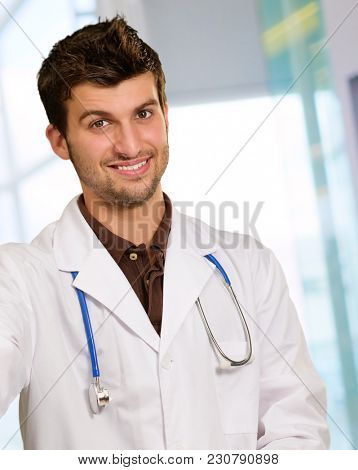 Young Doctor Holding Neck Brace Indoor