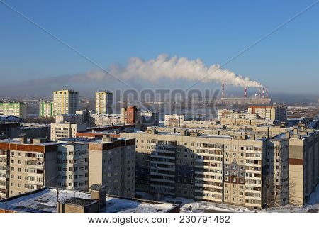 Pollution And Smoke From Chimneys Of Factory Or Power Plant. Pipe Plant Against The Morning Sky