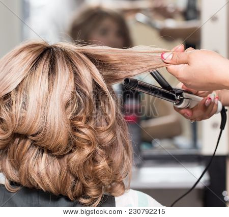 Female Hairstyles On Curling In A Beauty Salon .