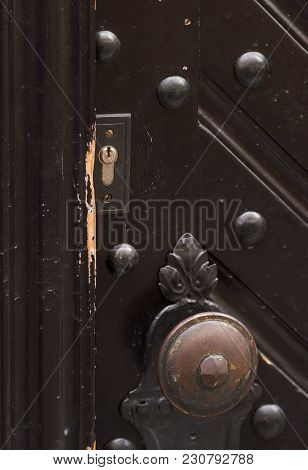 The Front Door Closeup. Keyhole And Handle