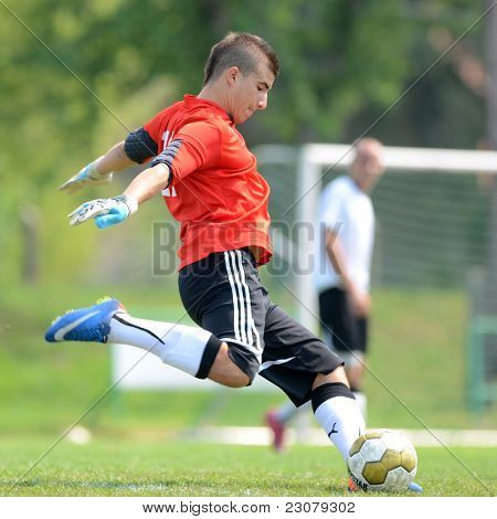 KAPOSVAR, HUNGARY - AUGUST 27: Daniel Baranya in action at the Hungarian National Championship under 18 game between Kaposvar (green) and Gyor (white) August 27, 2011 in Kaposvar, Hungary.