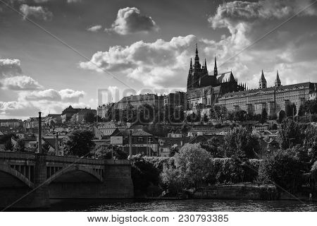 Black-and-white Landscape Of Prague. The Prospect Of A European City, Bridge, Buildings And The Cast