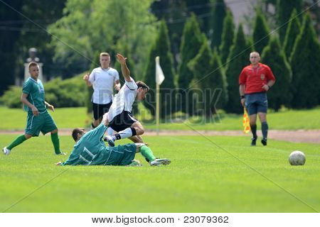 KAPOSVAR, HUNGARY - AUGUST 27: Richard Csaki (green 11) in action at the Hungarian National Championship under 18 game between Kaposvar (green) and Gyor (white) August 27, 2011 in Kaposvar, Hungary.