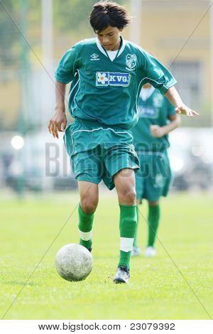 KAPOSVAR, HUNGARY - AUGUST 27: Valentin Hadaro in action at the Hungarian National Championship under 18 game between Kaposvar (green) and Gyor (white) August 27, 2011 in Kaposvar, Hungary.