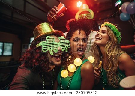 Friends Enjoying Amazing Party At Pub