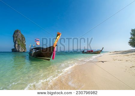 Traditional long-tail boat on the beach