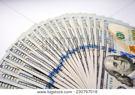 Pile Of One Hundred Dollar Banknotes As Money Background. New Dollar Bills Spread In Financial Conce