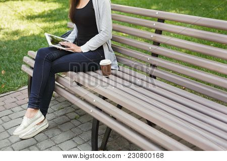Unrecognizable Woman Using Digital Tablet. Girl Working Outdoors On Portable Computer, Copy Space. T