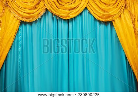Theater Stage With Yellow And Blue Curtains. Performance.