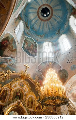 Orel, Russia - July 28, 2016: Russian Orthodox Church Interior. Dome, Huge Chandelier With Candles A
