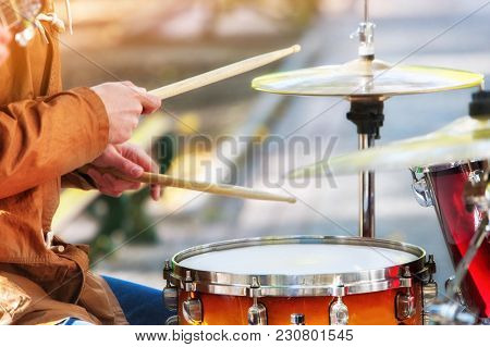Music street performers on autumn outdoor. Middle section of body part. Color tone on shiny sunlight background. People earn their living by musical performances.