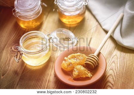 Honey In Jar With Honey Dipper On Vintage Wooden Background Horizontal