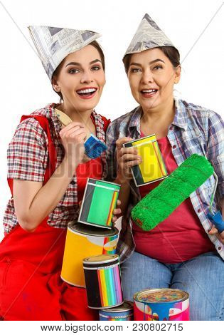 Repair home women holding bank with paint for wallpaper. Elderly mother and daughter renovation apartment on isolated. Loan for housing for family.