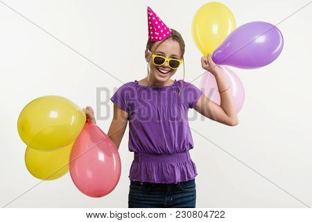 Cheerful Teenage Girl 12, 13 Years Old, With Balloons, In Festive Hat On White Background
