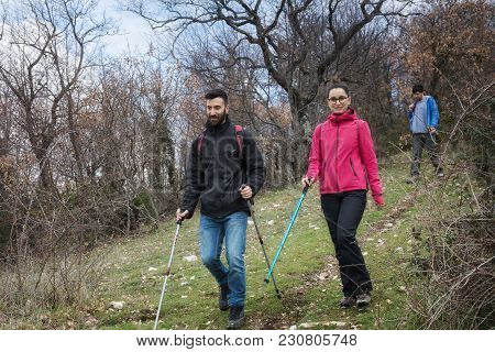 Two Young Hikers Explore Trails In The Mountains