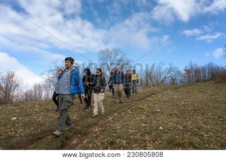 A Group Of Hikers Explore Mountain Paths