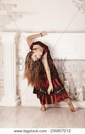dancing blonde in red dress