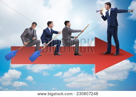 Businessman on line chart in business concept