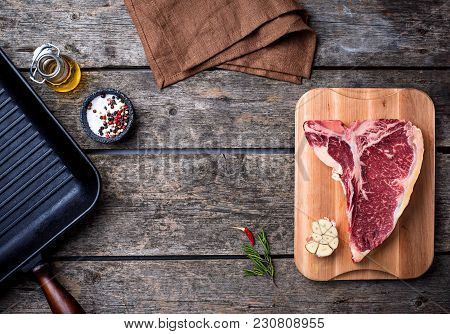 Raw T-bone Steak And  Iron Grill Pan. Top View