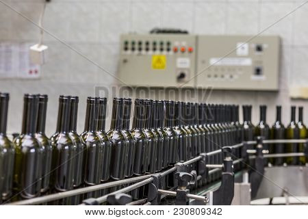 Automated Wine Bottle Filling And Labeling Line