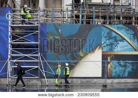 London, England - March 30, 2017, Workers Install Structures On Fence Near The National Gallery. On